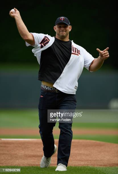 Garrett Bradbury of the Minnesota Vikings delivers a ceremonial pitch before the game between the Minnesota Twins and the Detroit Tigers on August 25...