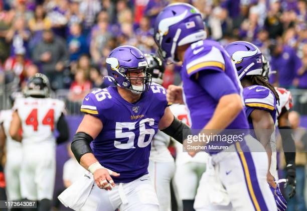 Garrett Bradbury of the Minnesota Vikings reacts after a touchdown score by Dalvin Cook in the third quarter of the game against the Atlanta Falcons...