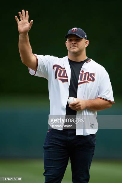 Garrett Bradbury of the Minnesota Vikings waves before he delivers a ceremonial pitch before the game between the Minnesota Twins and the Detroit...