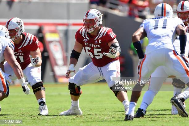 Garrett Bradbury of the North Carolina State Wolfpack in action against the Virginia Cavaliers at CarterFinley Stadium on September 29 2018 in...