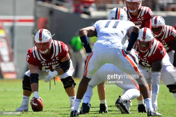 Garrett Bradbury of the North Carolina State Wolfpack prepares to snap the ball against the Virginia Cavaliers at CarterFinley Stadium on September...