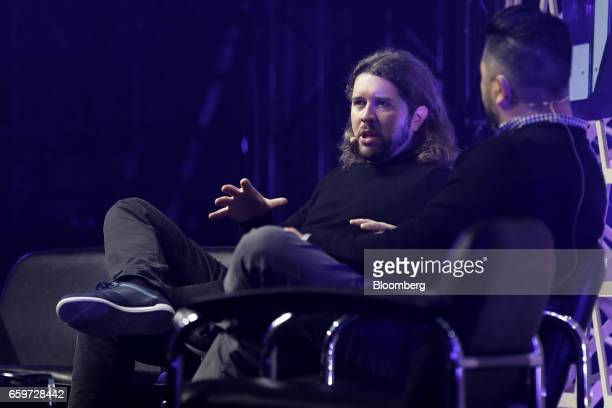 Garrett Camp cofounder and chairman of Uber Technologies Inc left speaks as Steve Jang angel investor looks on during the Slush Tokyo startup event...