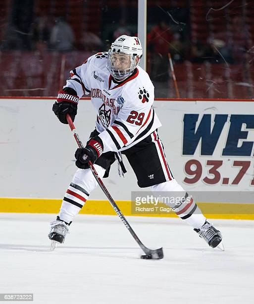 """Garrett Cecere of the Northeastern Huskies skates against the New Hampshire Wildcats during NCAA hockey at Fenway Park during """"Frozen Fenway"""" on..."""