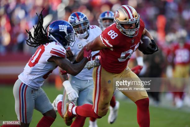 Garrett Celek of the San Francisco 49ers breaks a tackle on way to a 47yard touchdown against the New York Giants during their NFL game at Levi's...
