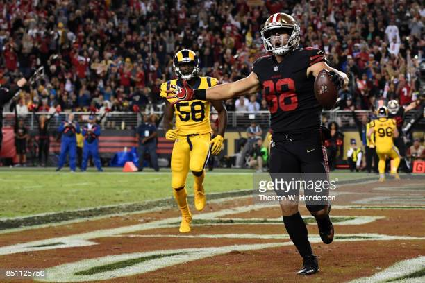 Garrett Celek of the San Francisco 49ers celebrates after scoring against the Los Angeles Rams during their NFL game at Levi's Stadium on September...