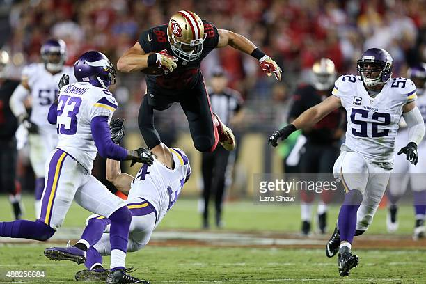 Garrett Celek of the San Francisco 49ers is hit after a catch in the first half of their NFL game against the Minnesota Vikings at Levi's Stadium on...