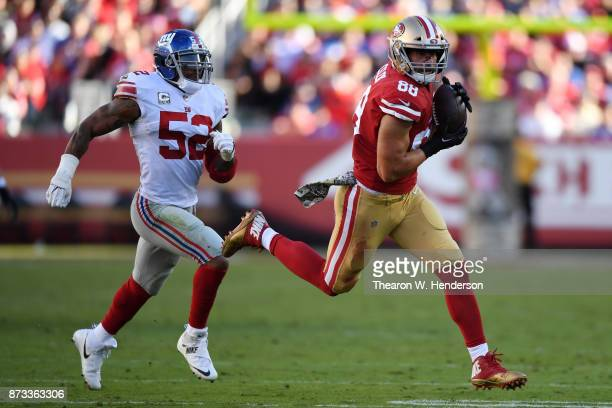 Garrett Celek of the San Francisco 49ers makes a catch on way to a 47yard touchdown against the New York Giants during their NFL game at Levi's...