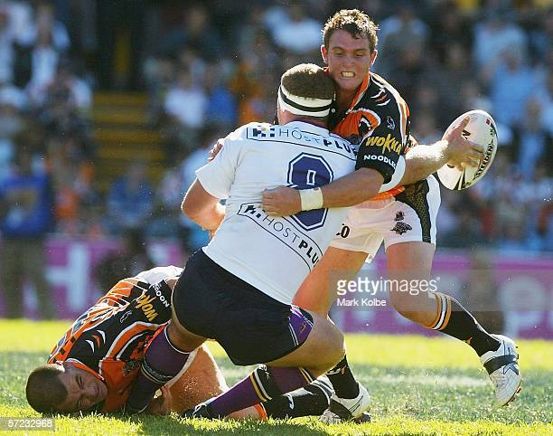 Garrett Crossman of the Storm gets a onehanded pass away during the round four NRL match between the Wests Tigers and the Melbourne Storm at...