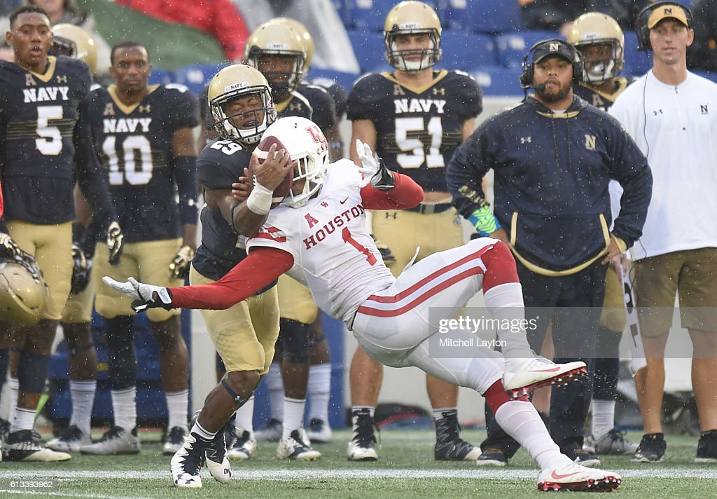 Garrett Davis #1 of the Houston Cougars and Darryl Bonner #29 of the Navy Midshipmen fight for a throw ball in the second period during a football game at Navy-Marines Memorial Stadium on October 8, 2016 in Annapolis, Maryland.