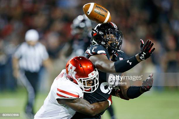 Garrett Davis of the Houston Cougars breaks up a pass intended for DJ Dowdy of the Cincinnati Bearcats in the first half at Nippert Stadium on...