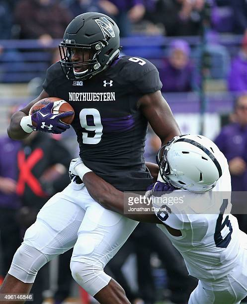 Garrett Dickerson of the Northwestern Wildcats is tackled by Malik Golden of the Penn State Nittany Lions at Ryan Field on November 7 2015 in...