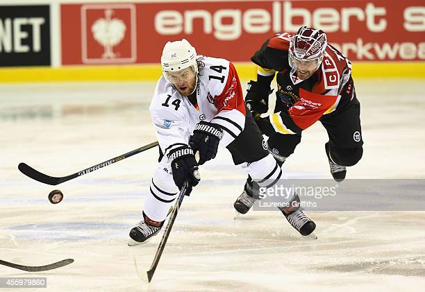 Garrett Festerling of Hamburg Freezers battles with Brandon Benedict of Nottingham Panthers during the Champions Hockey League group stage game...