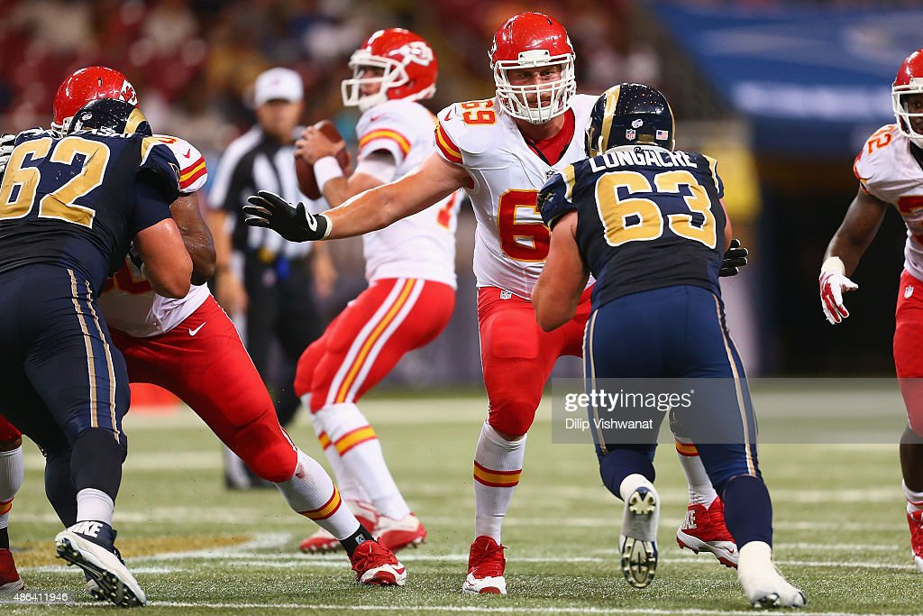 Garrett Frye #69 of the Kansas City Chiefs blocks against Matt Longacre #63 of the St. Louis Rams in the fourth quarter during a pre-season game at the Edward Jones Dome on September 3, 2014 in St. Louis, Missouri.