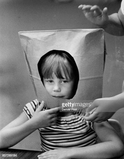 Garrett Gibbons above tries on his space helmet before decorating it while the day's events have taken their toll on Brian Foot left causing him to...