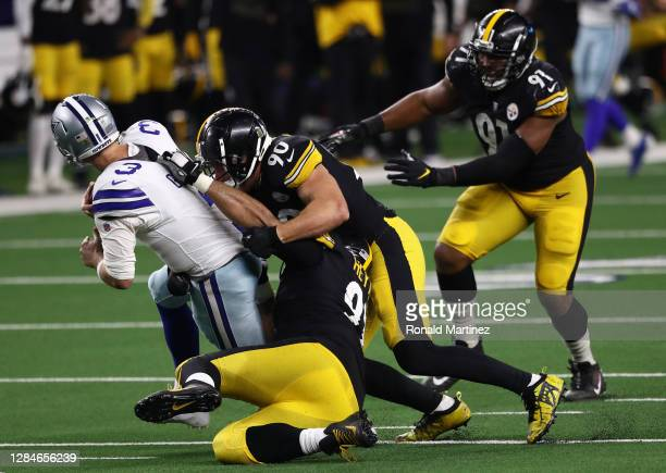 Garrett Gilbert of the Dallas Cowboys is sacked by T.J. Watt and Cameron Heyward of the Pittsburgh Steelers in the fourth quarter at AT&T Stadium on...