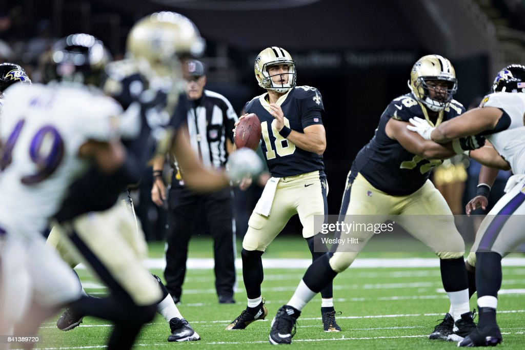 Garrett Grayson #18 of the New Orleans Saints looks downfield for a receiver during a preseason game against the Baltimore Ravens at Mercedes-Benz Superdome on August 31, 2017 in New Orleans, Louisiana. The Ravens defeated the Saints 14-13.
