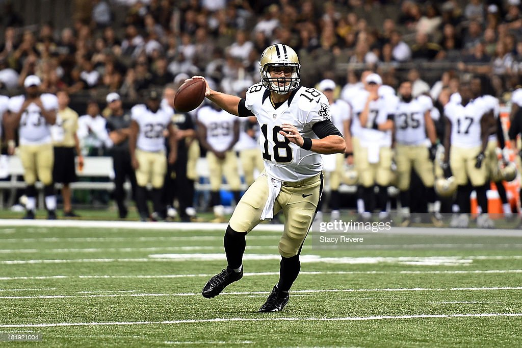 Garrett Grayson #18 of the New Orleans Saints looks to pass during the fourth quarter of a preseason game against the New England Patriots at the Mercedes-Benz Superdome on August 22, 2015 in New Orleans, Louisiana.