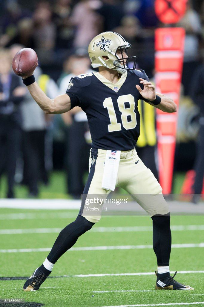 Garrett Grayson #18 of the New Orleans Saints throws a pass during a preseason game against the Baltimore Ravens at Mercedes-Benz Superdome on August 31, 2017 in New Orleans, Louisiana. The Ravens defeated the Saints 14-13.