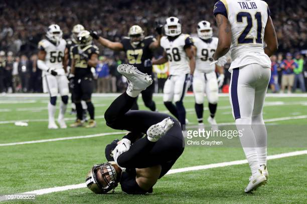 Garrett Griffin of the New Orleans Saints scores touchdown thrown by Drew Brees against the Los Angeles Rams during the first quarter in the NFC...