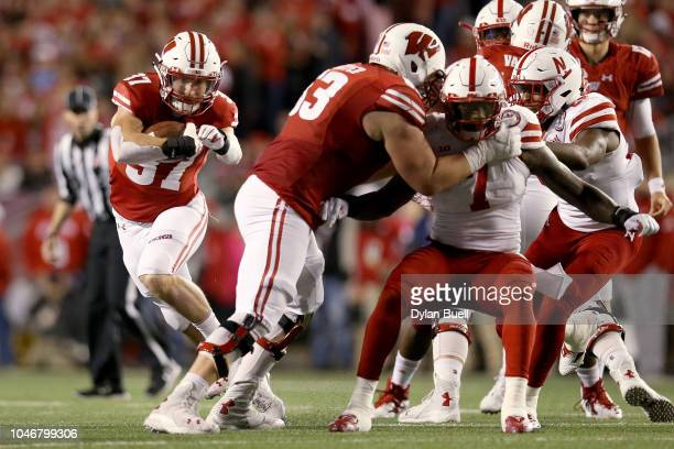 Garrett Groshek of the Wisconsin Badgers runs with the ball in the second quarter against the Nebraska Cornhuskers at Camp Randall Stadium on October...