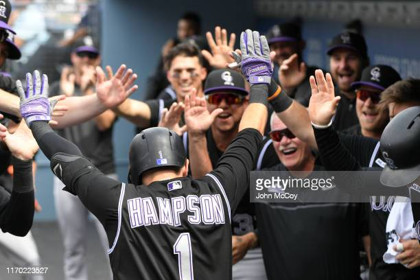 Garrett Hampson of the Colorado Rockies celebrates in the dugout after his first inning home run against the Los Angeles Dodgers at Dodger Stadium on...