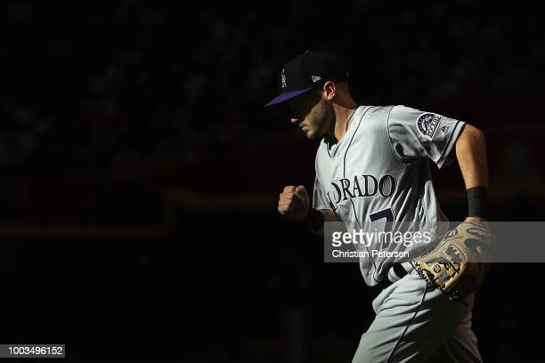 Nolan Arenado of the Colorado Rockies warms up on deck during the first inning of the MLB game against the Arizona Diamondbacks at Chase Field on...