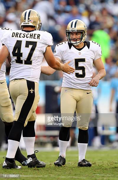Garrett Hartley and Justin Drescher of the New Orleans Saints celebrate after making a field goal against the Tennessee Titans at LP Field on August...