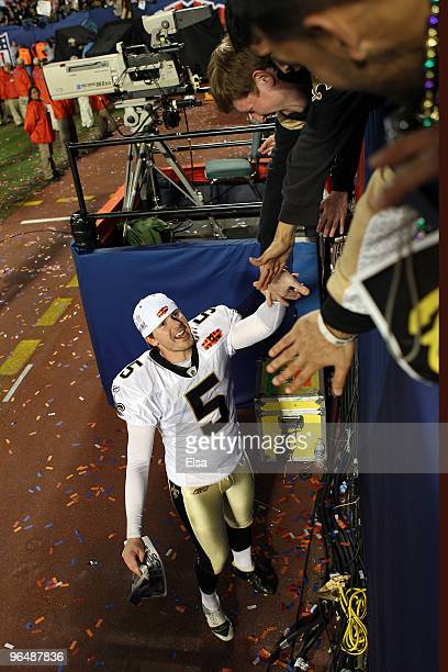 Garrett Hartley of the New Orleans Saints celebrates with fans after defeating the Indianapolis Colts during Super Bowl XLIV on February 7 2010 at...
