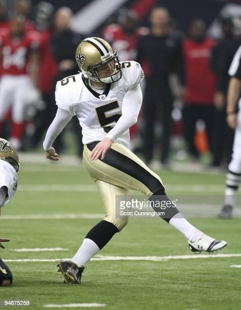 Garrett Hartley of the New Orleans Saints kicks against the Atlanta Falcons at the Georgia Dome on December 13, 2009 in Atlanta, Georgia. The Saints...