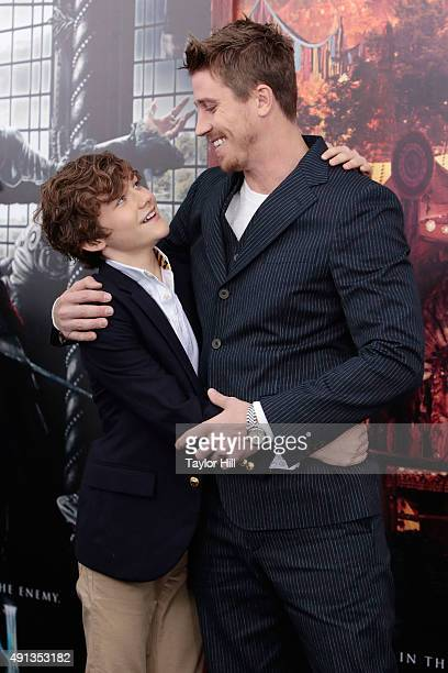 Garrett Hedlund and Levi Miller attend the premiere of 'Pan' at Ziegfeld Theater on October 4 2015 in New York City