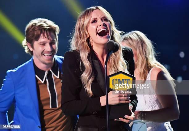 Garrett Hedlund Carly Pearce and Lauren Alaina speak onstage at the 2018 CMT Music Awards at Bridgestone Arena on June 6 2018 in Nashville Tennessee