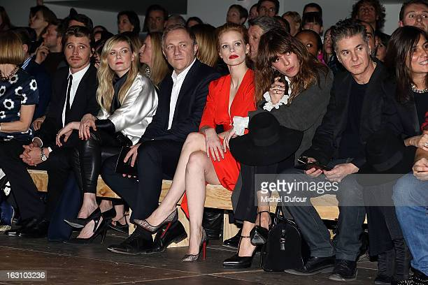Garrett Hedlund Kirsten Dunst Francois Henri Pinault Jessica Chastain Lou Doillon and Etienne Daho attend the Saint Laurent Fall/Winter 2013...