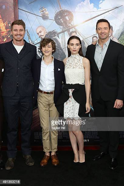 Garrett Hedlund Levi Miller Rooney Mara and Hugh Jackman attend the premiere of 'Pan' at Ziegfeld Theater on October 4 2015 in New York City