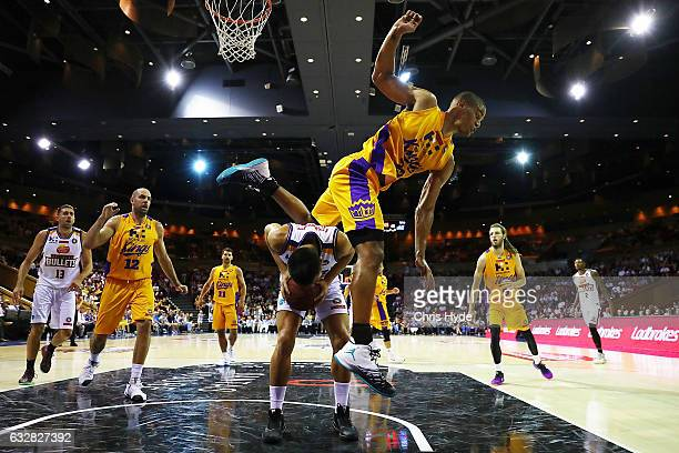 Garrett Jackson of the Kings jumps over Reuben Te Rangi of the Bullets during the round 17 NBL match between the Brisbane Bullets and the Sydney...