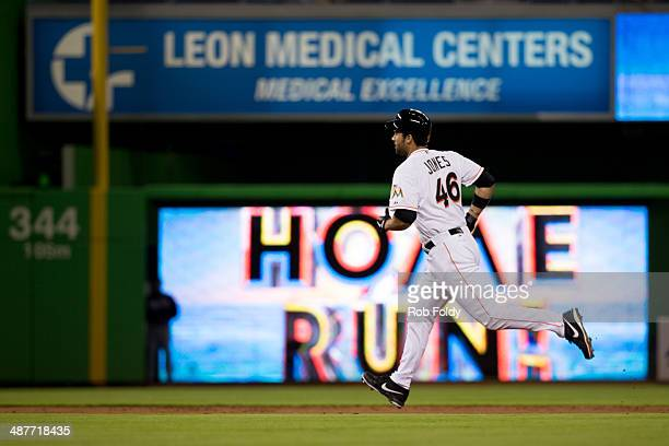 Garrett Jones of the Miami Marlins runs the bases after hitting a solo home run during the second inning the game against the Atlanta Braves at...