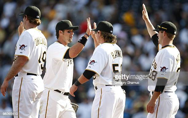 Garrett Jones of the Pittsburgh Pirates celebrates with teammates after a 115 win over the Los Angeles Dodgers during the Home Opener for the...