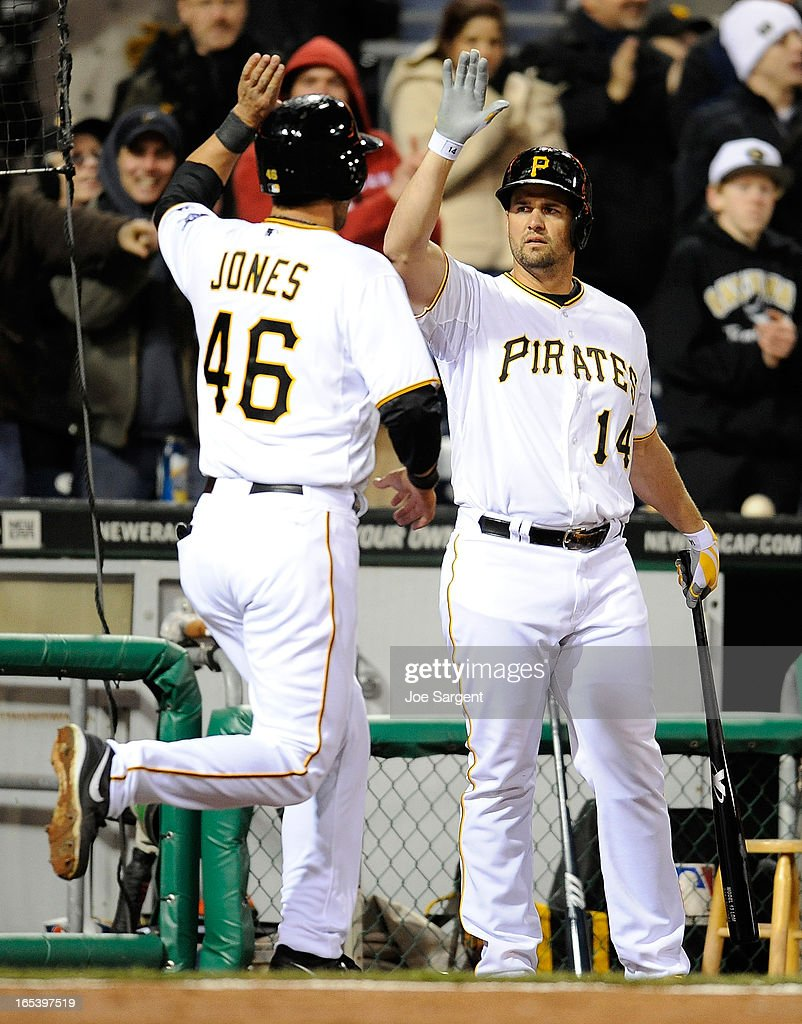 Garrett Jones #46 of the Pittsburgh Pirates is congratulated by Gaby Sanchez #14 after scoring in the fourth inning against the Chicago Cubs on April 3, 2013 at PNC Park in Pittsburgh, Pennsylvania.