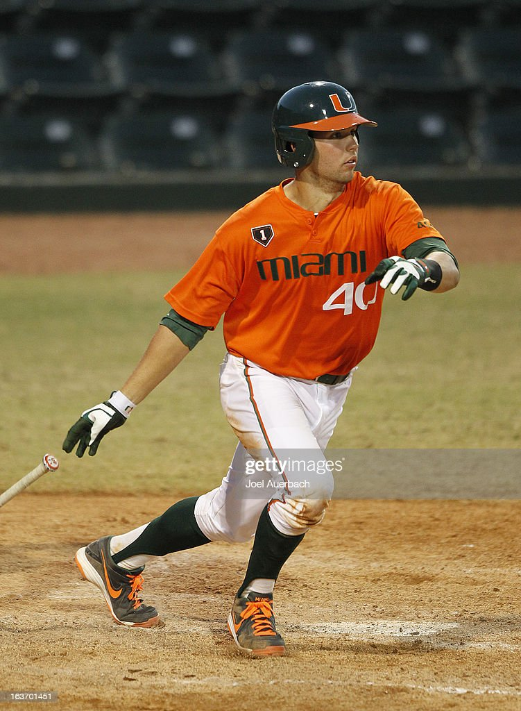 Garrett Kennedy #40 of the Miami Hurricanes hits the ball to right field against the Illinois State Redbirds on March 13, 2013 at Alex Rodriguez Park at Mark Light Field in Coral Gables, Florida. The Hurricanes defeated the Redbirds 9-2.