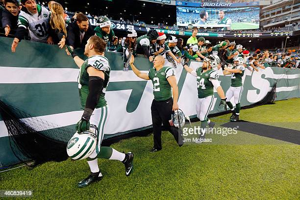Garrett McIntyre, Nick Folk, Nick Bellore and Zach Sudfeld of the New York Jets greet fans after a game against the Cleveland Browns on December 22,...