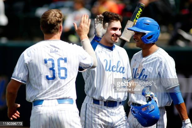 Garrett Mitchell of UCLA Jake Pries of UCLA and Chase Strumpf of UCLA highfive following Mitchell's home run during a baseball game against...