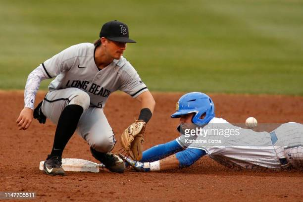 Garrett Mitchell of UCLA slides into second base as Laine Huffman of Long Beach State reaches for the ball during a baseball game at Jackie Robinson...