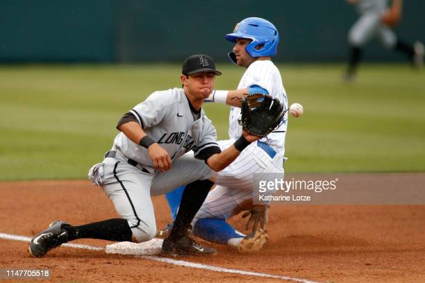 Garrett Mitchell of UCLA slides into third base as Santiago Rivera of Long Beach State prepares to catch the ball during a baseball game at Jackie...