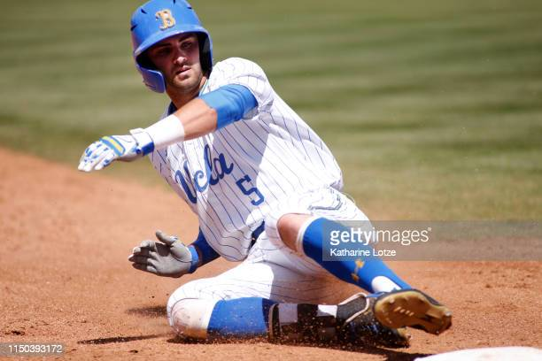 Garrett Mitchell of UCLA slides into third base during a baseball game against University of Washington at Jackie Robinson Stadium on May 19 2019 in...