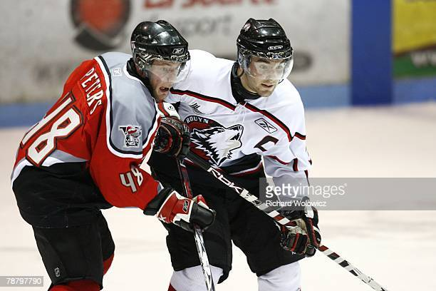 Garrett Peters of the Drummondville Voltigeurs and Marc-Andre Bourdon of the Rouyn-Noranda Huskies battle for position during the game at the Centre...