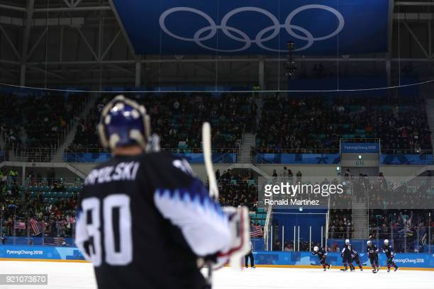 Garrett Roe of the United States celebrates with his teammates after scoring a goal against Jan Laco of Slovakia in the third period during the Men's...