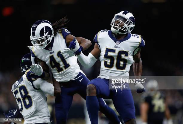 Garrett Sickels and Marqui Christian of the Los Angeles Rams celebrate breaaking up a pass late in the fourth quarter of the game against the New...