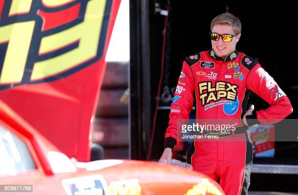 Garrett Smithley driver of the Flex Glue Chevrolet stands in the garage area during practice for the NASCAR Xfinity Series DC Solar 200 at ISM...