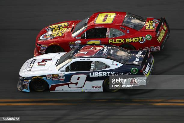 Garrett Smithley driver of the Flex Shot Chevrolet races William Byron driver of the Liberty University Chevrolet during the NASCAR XFINITY Series...