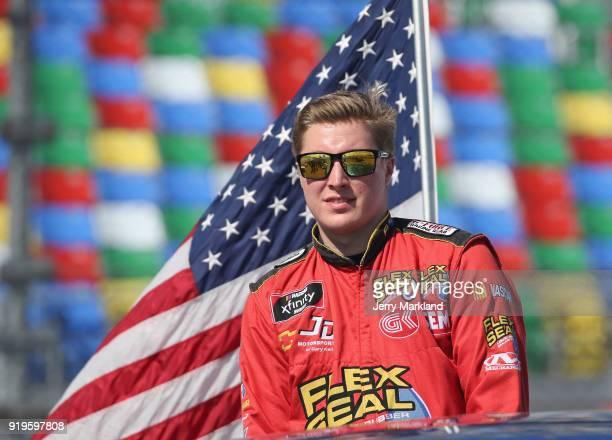 Garrett Smithley driver of the Flex Tape Chevrolet is introduced prior to the NASCAR Xfinity Series PowerShares QQQ 300 at Daytona International...