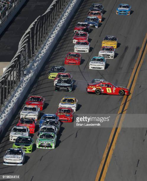 Garrett Smithley driver of the Flex Tape Chevrolet is involved in an ontrack incident during the NASCAR Xfinity Series PowerShares QQQ 300 at Daytona...